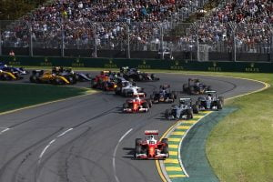 Albert Park, Melbourne, Australia. Sunday 20 March 2016. Sebastian Vettel, Ferrari SF16-H, leads Nico Rosberg, Mercedes F1 W07 Hybrid, Lewis Hamilton, Mercedes F1 W07 Hybrid, Kimi Raikkonen, Ferrari SF16-H, Max Verstappen, Toro Rosso STR11 Ferrari, Carlos Sainz Jr, Toro Rosso STR11 Ferrari, and the rest of the field at the start. World Copyright: Charles Coates/LAT Photographic ref: Digital Image _J5R3618